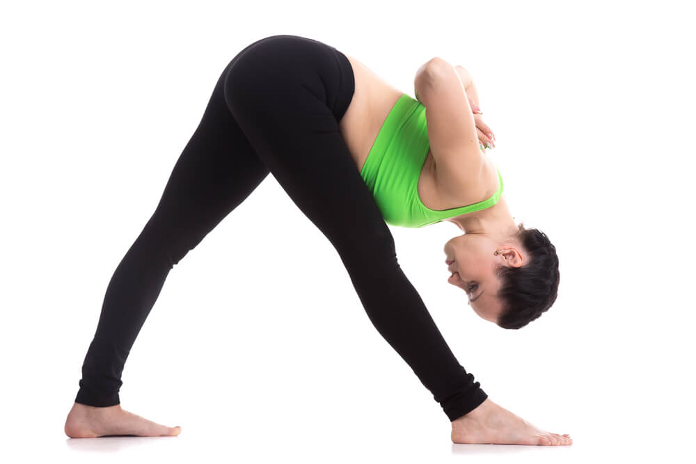 Yoga student practicing Parsvottanasana pose