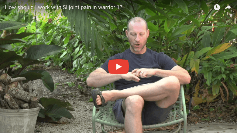 How should I work with SI joint pain in warrior 1?